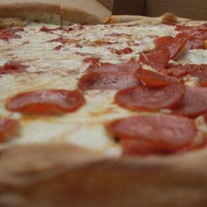 Caruso's pizza pie, half pepperoni half plain