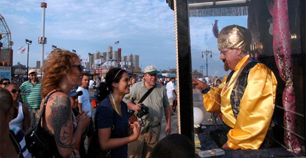 Zoltar predicts the future for onlookers from inside his glass box.