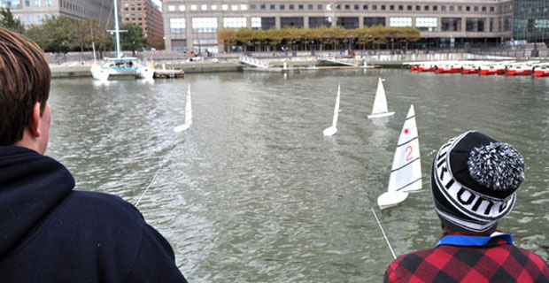 Remote controlled sailboats sail in the harbor